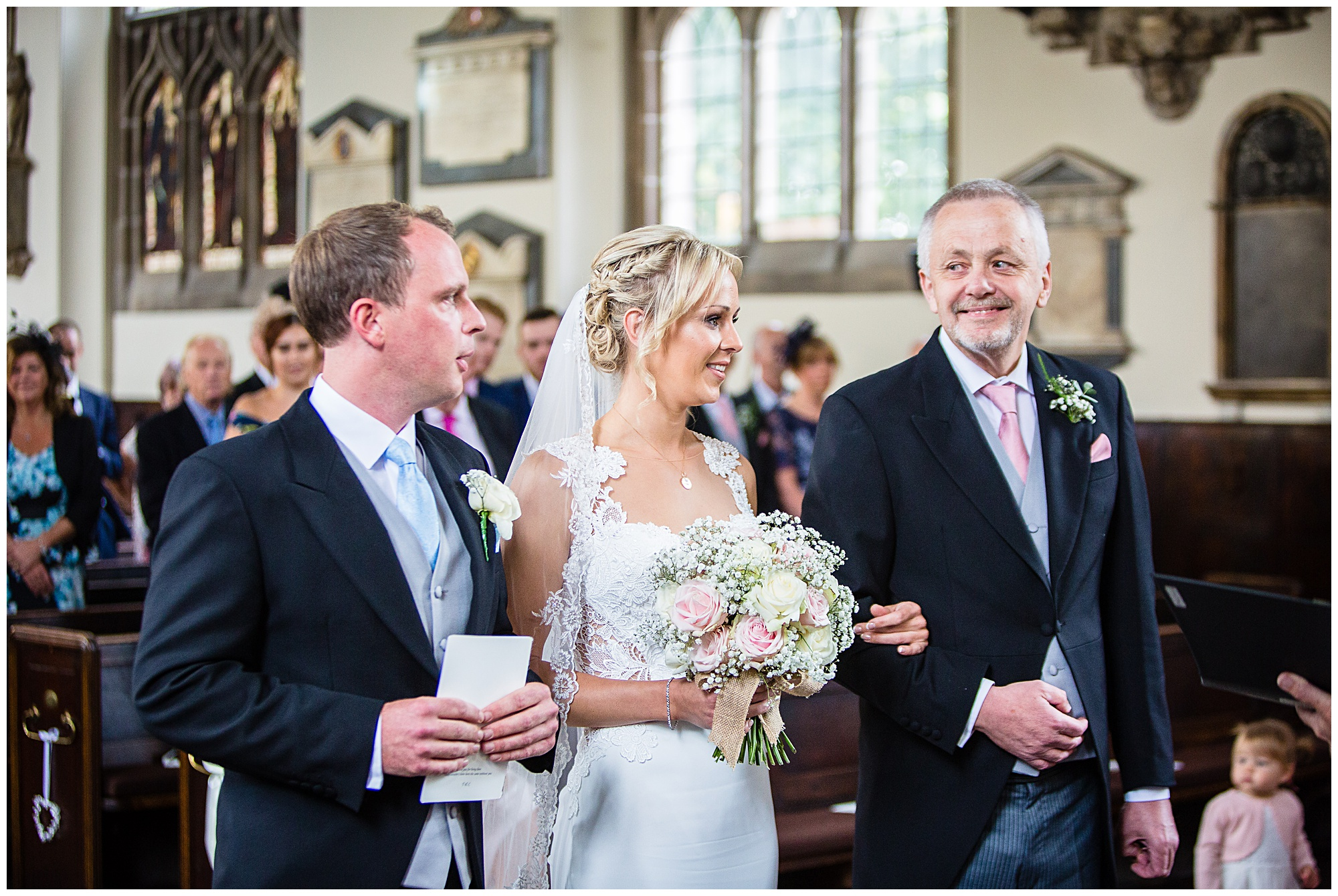 very pleased as punchdad looking at the groom - charlotte giddinngs photography