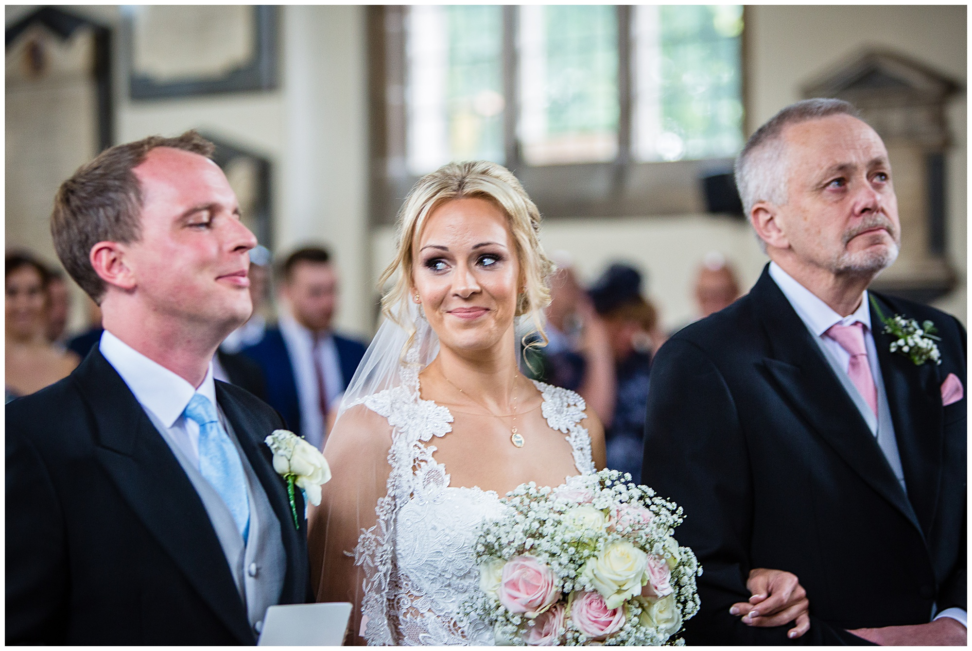 very happy bride looking at husband to be - very excited!