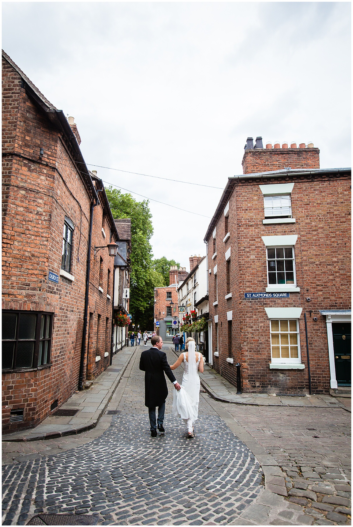 bride and groom walking away as newly weds from church - shropshire photographer