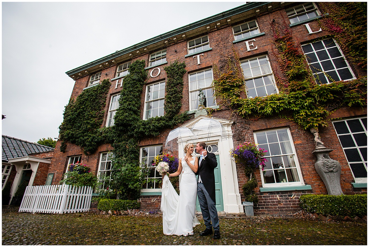 wide shot of bride and groom outside the mytton and mermaid, shrewsbury