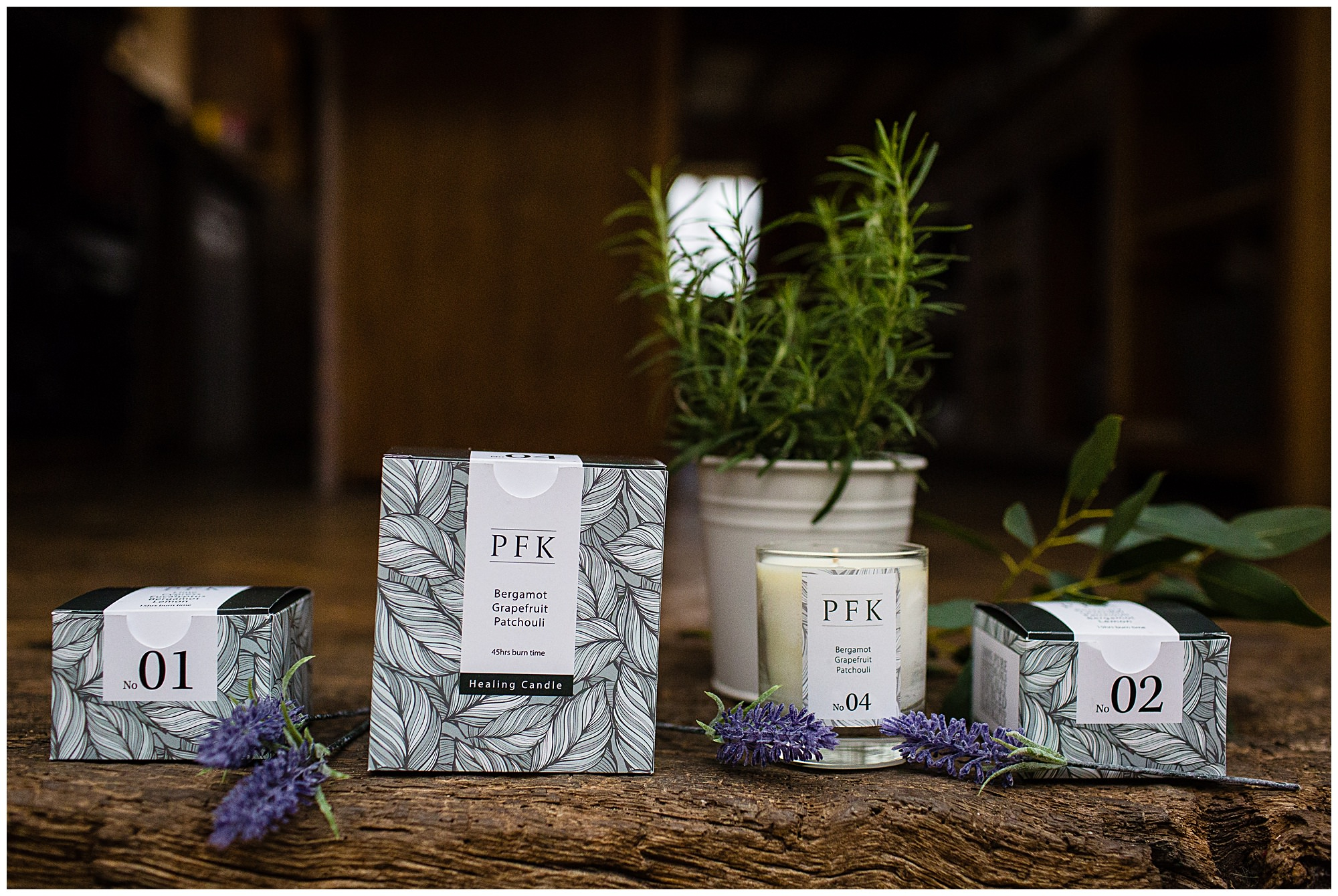 PFK candles on wooden surface with natural ingredients and with box packaging
