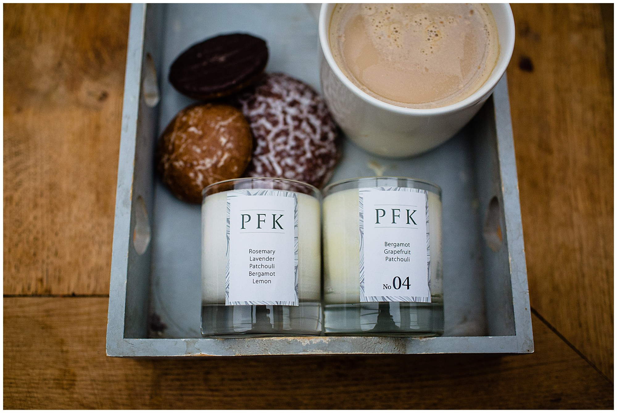 candles on grey wooden tray with chocolate biscuits, hot cup of coffee - Lifestyle Photographer Shropshire