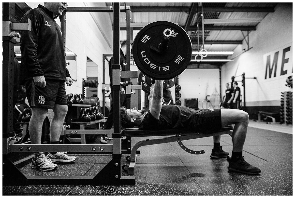 guy carrying out bench press and another spotting - gyms in whitchurch, shropshire