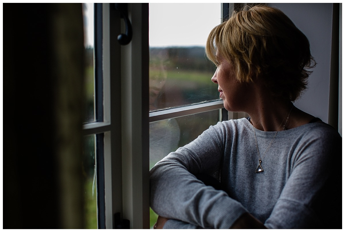Paula Fox Kirkham sat in the window looking at the beautiful view from her shropshire home