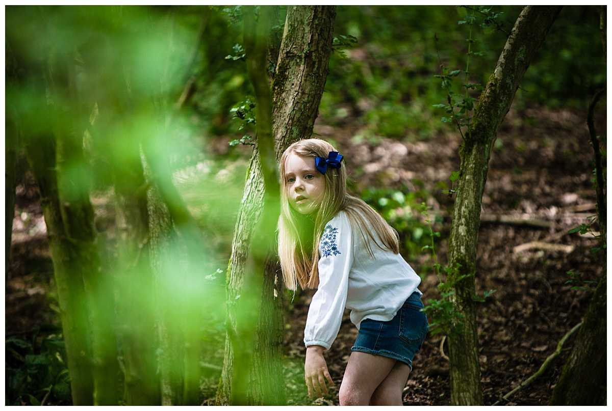 little girl looking through the trees - whitchurch, photographer family photographer