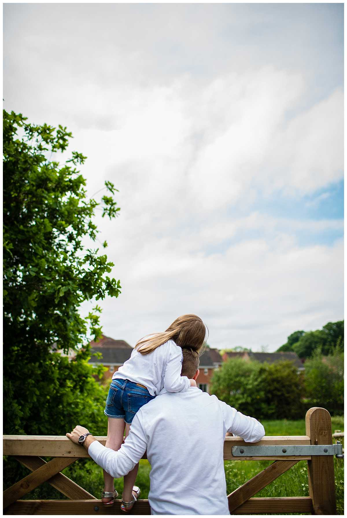 photo taken from behind as daughter is cuddling from behind