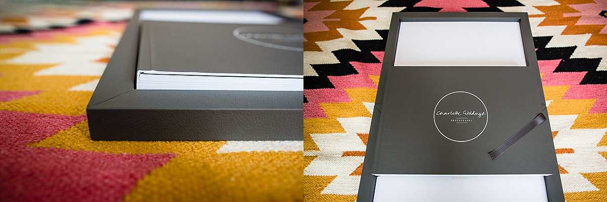 closer view of the edge of the charcoal box and the spine of the wedding album . - shropshire wedding photographer