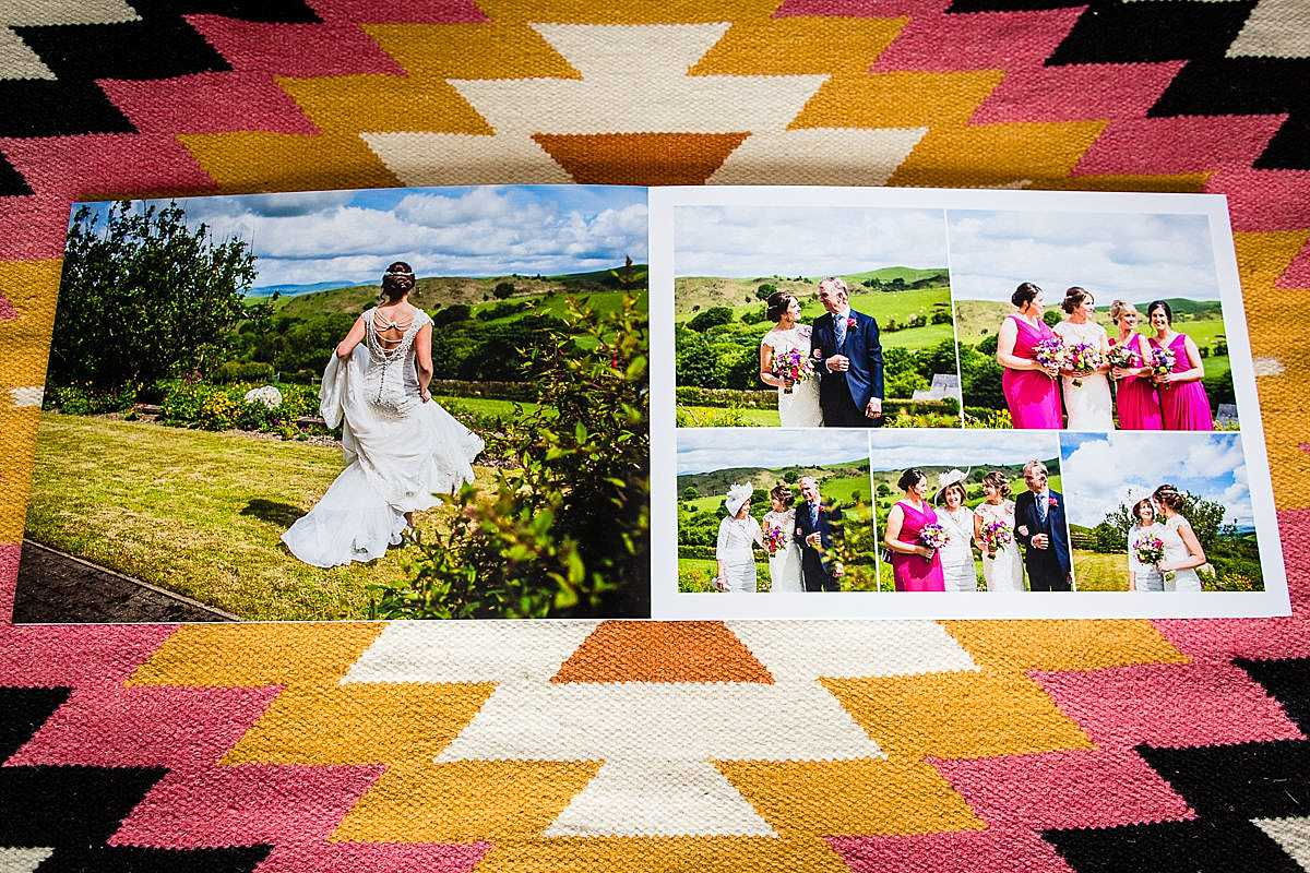 wedding album lying open on a rug with photos of bridal prep and with the bride with her bridesmaids and family