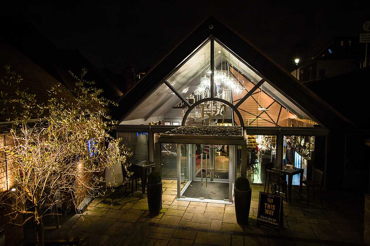 exterior shot of 1539, chester race course all light up at night time