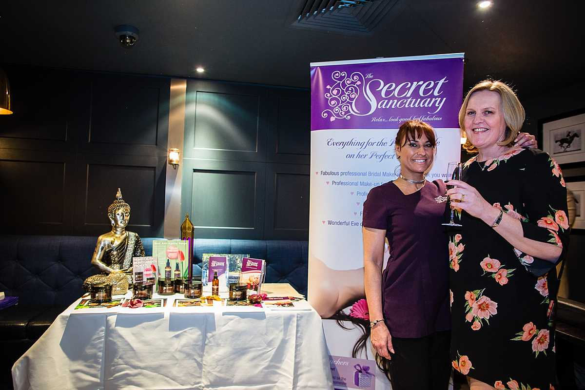 business owner and event organiser having a photo together with beauty products