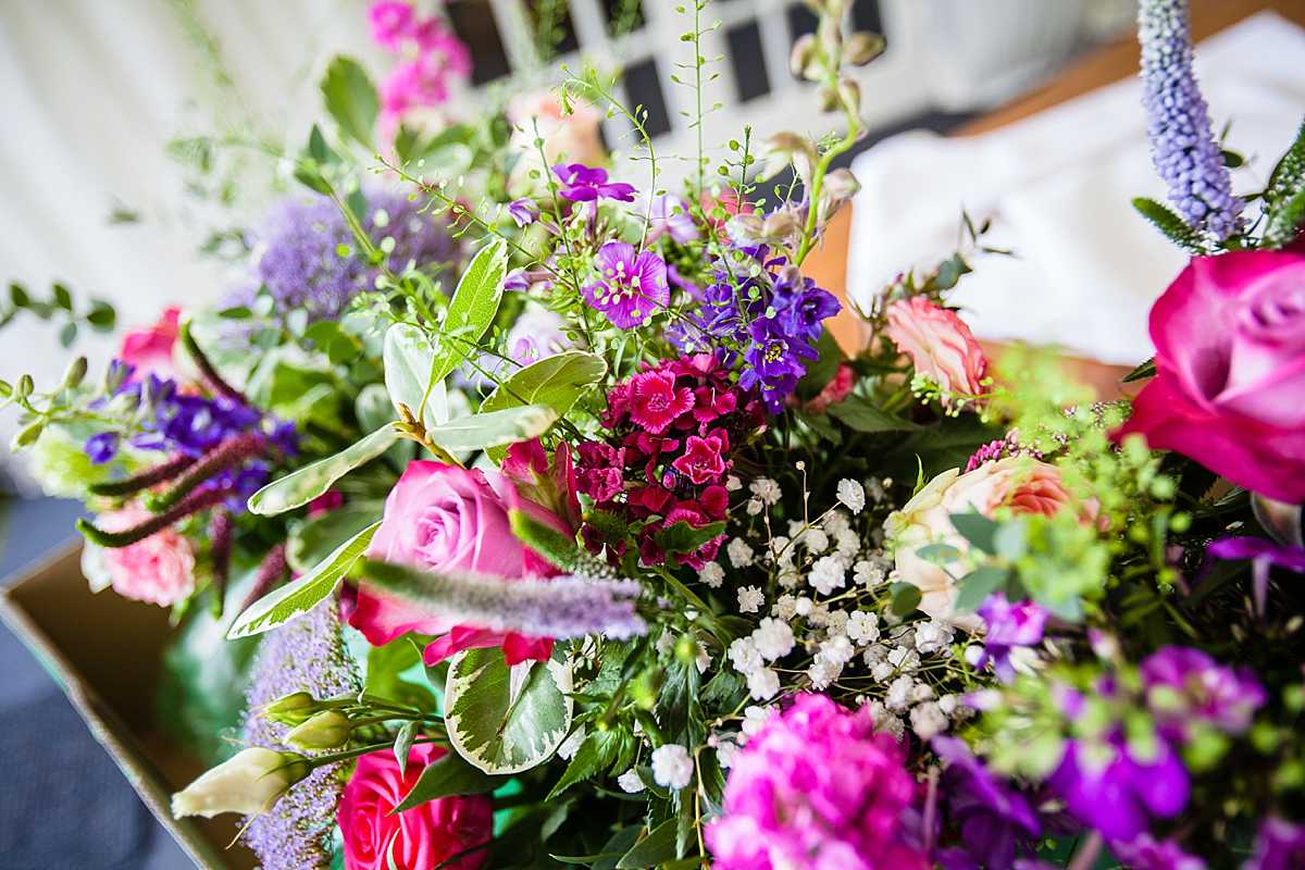 vibrant colour flowers with lots of bright pinks, purples and cream for venue decor