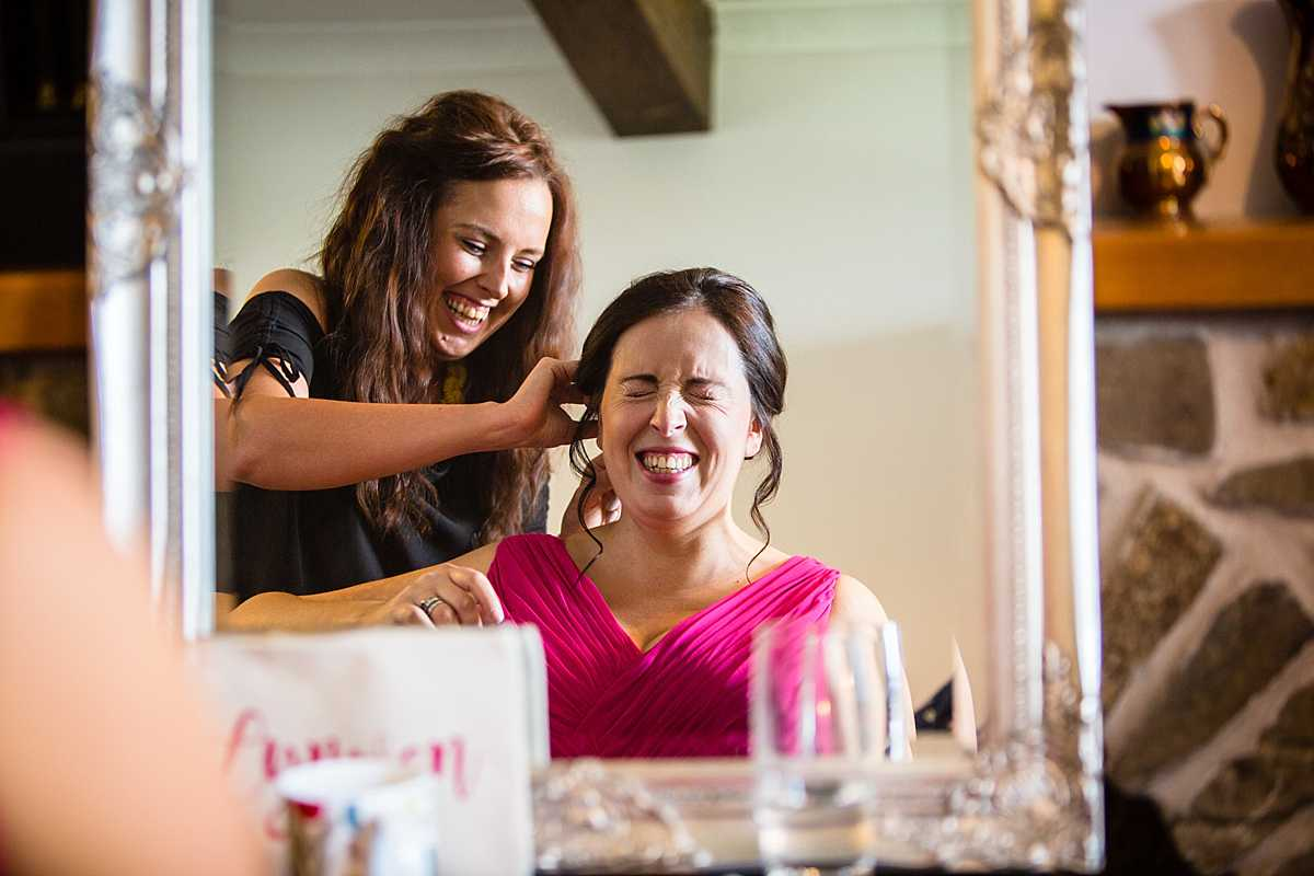 bridesmaid laughing with the makeup artist - funny expression - wedding in Machynlleth