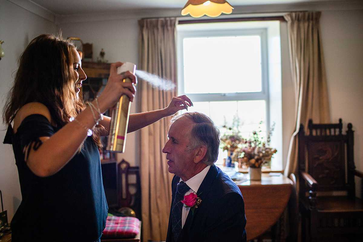 father of the bride having hairspray applied to his hair! wedding in Machynlleth