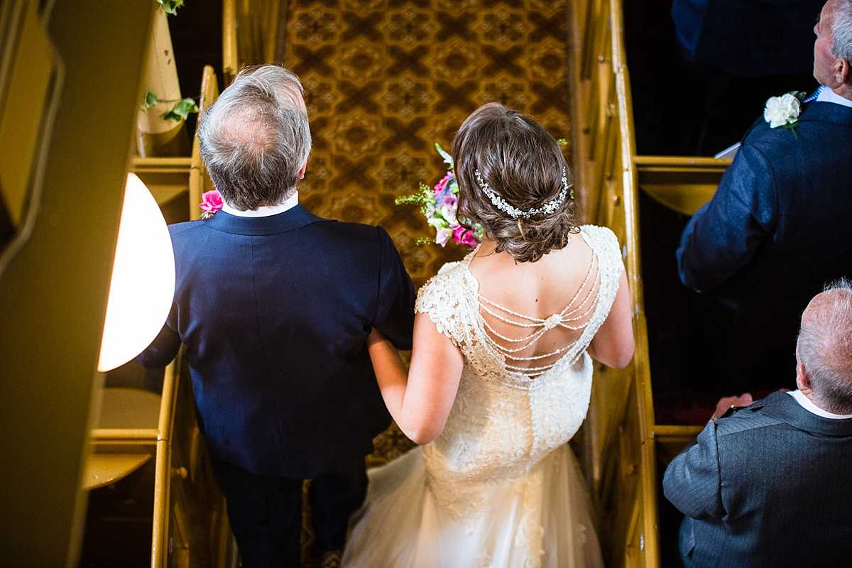 aerial sot of the bride and father of the bride linked arms as he walk into aberhosan chapel - wedding in Machynlleth