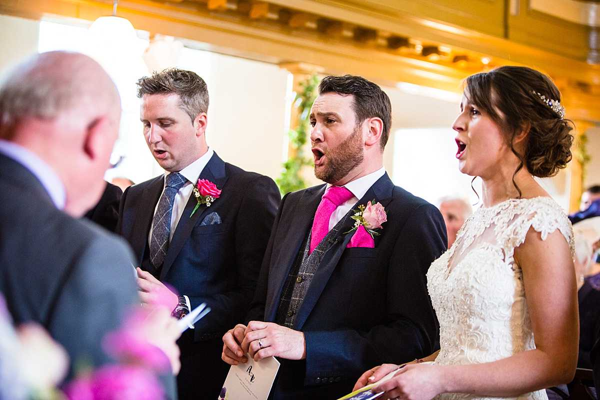 bride and groom singing on with passion and top of their lungs in aberhosan chapel ceremony