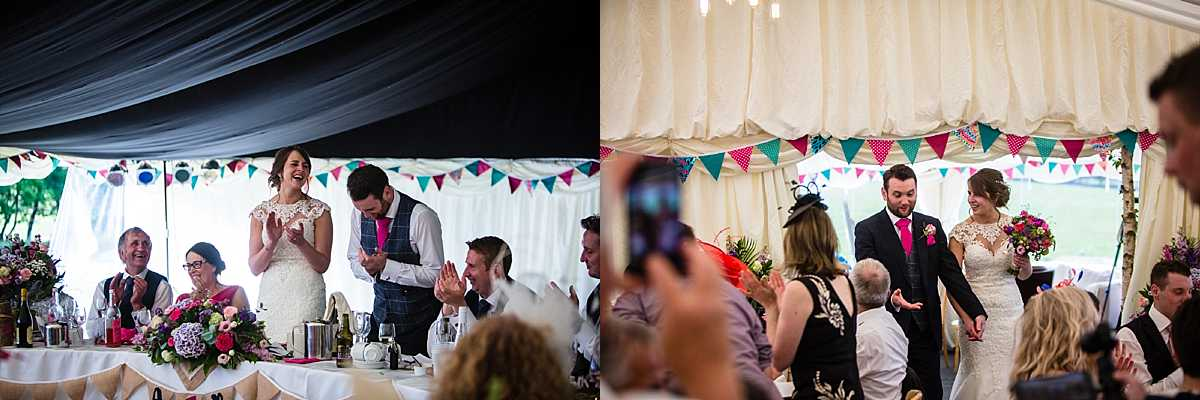 bride and groom walking into the marquee and applauding when they get to the top table at marquee wedding