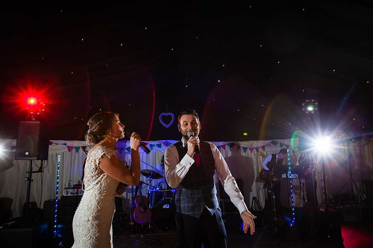 bride and groom in full song together during their first dance