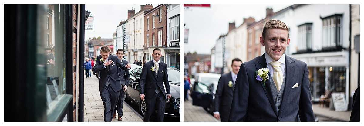 groom walking up whitchurch shropshire high street towards the black bear pub before he goes to church