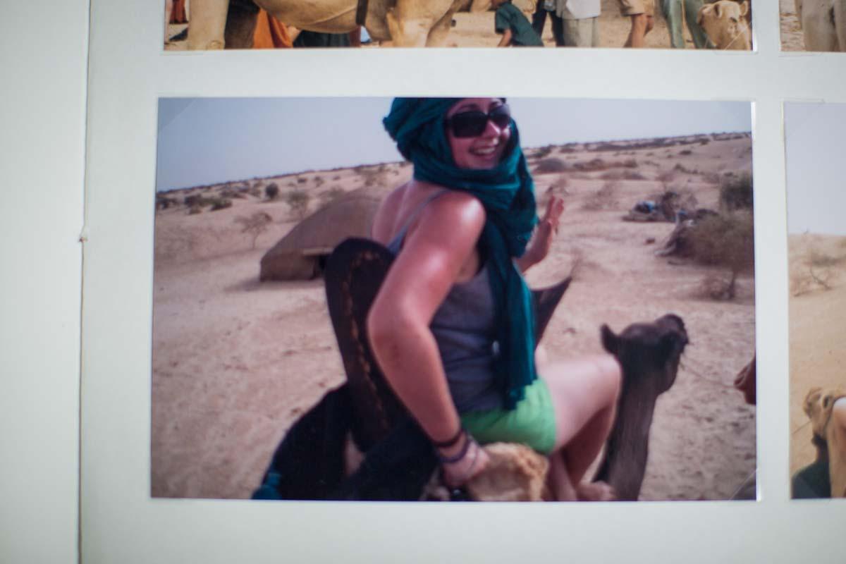 charlotte giddings looking over shoulder as sat on a camel