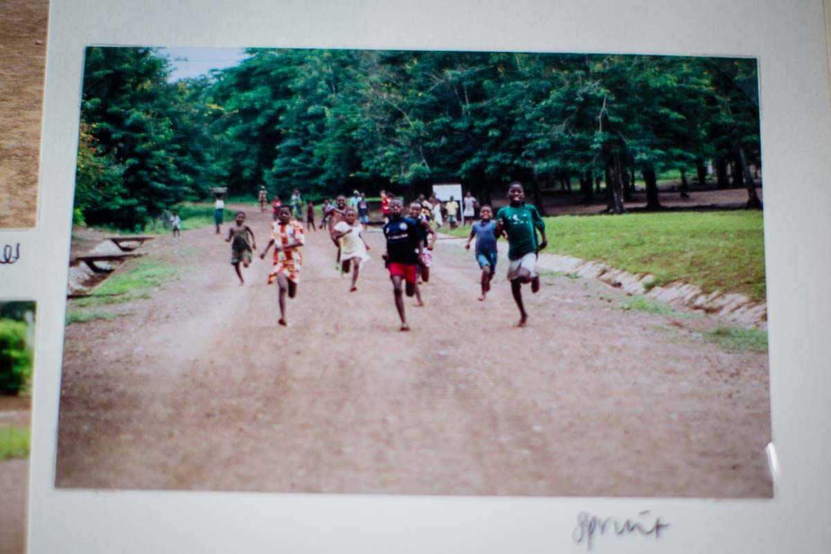 Ghanian kids running as fast as they can at an organised sports day