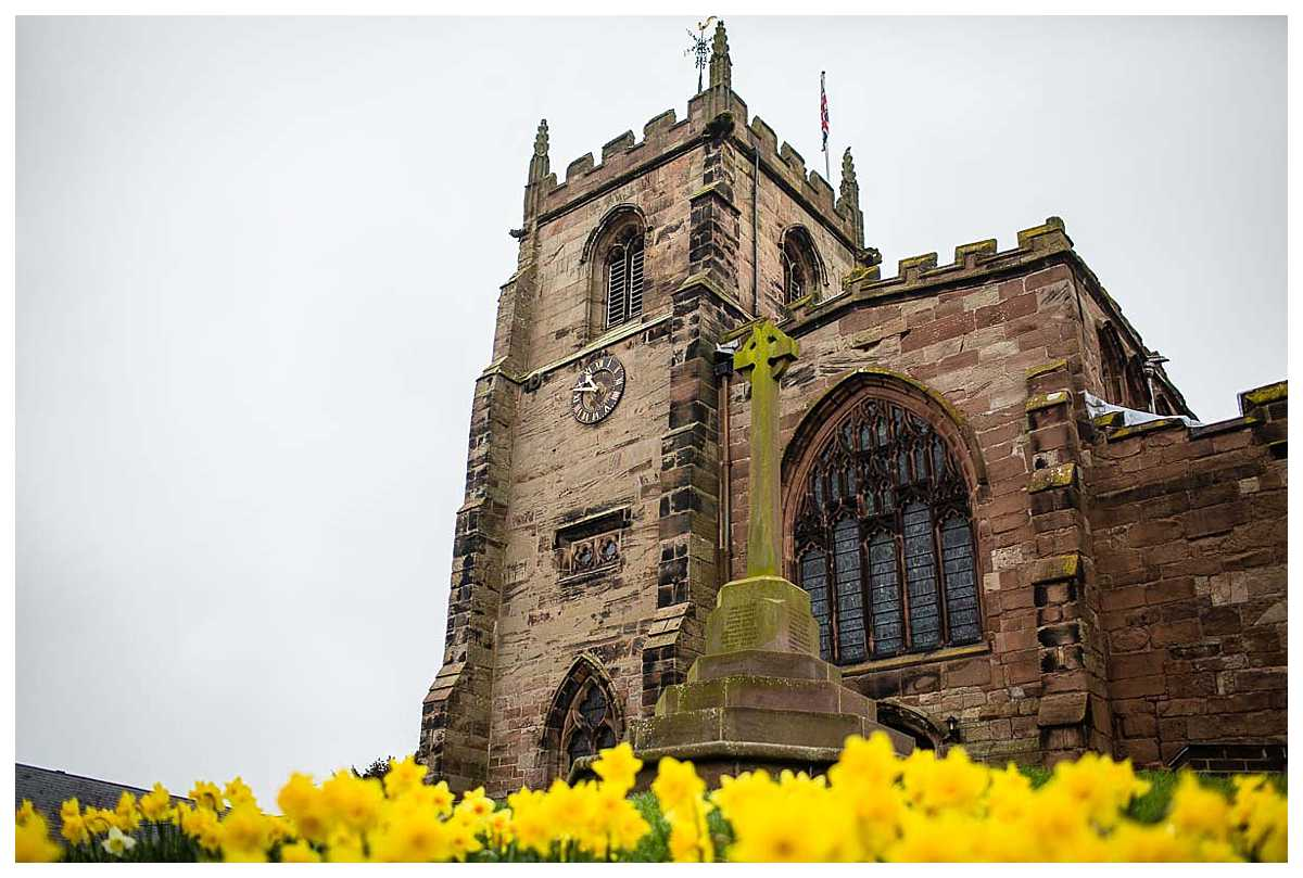 st james church, audlem in full bloom of yellow daffodils in spring