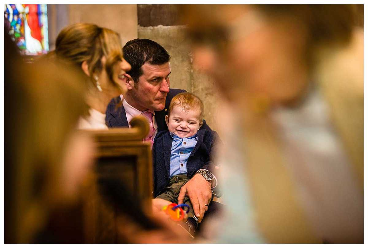 dad and baby boy giggling together in church, cheshire