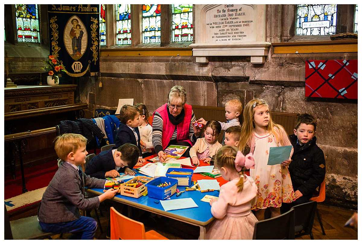 gathering of kids around the craft table in church - st james's audlem, cheshire, christening photographer