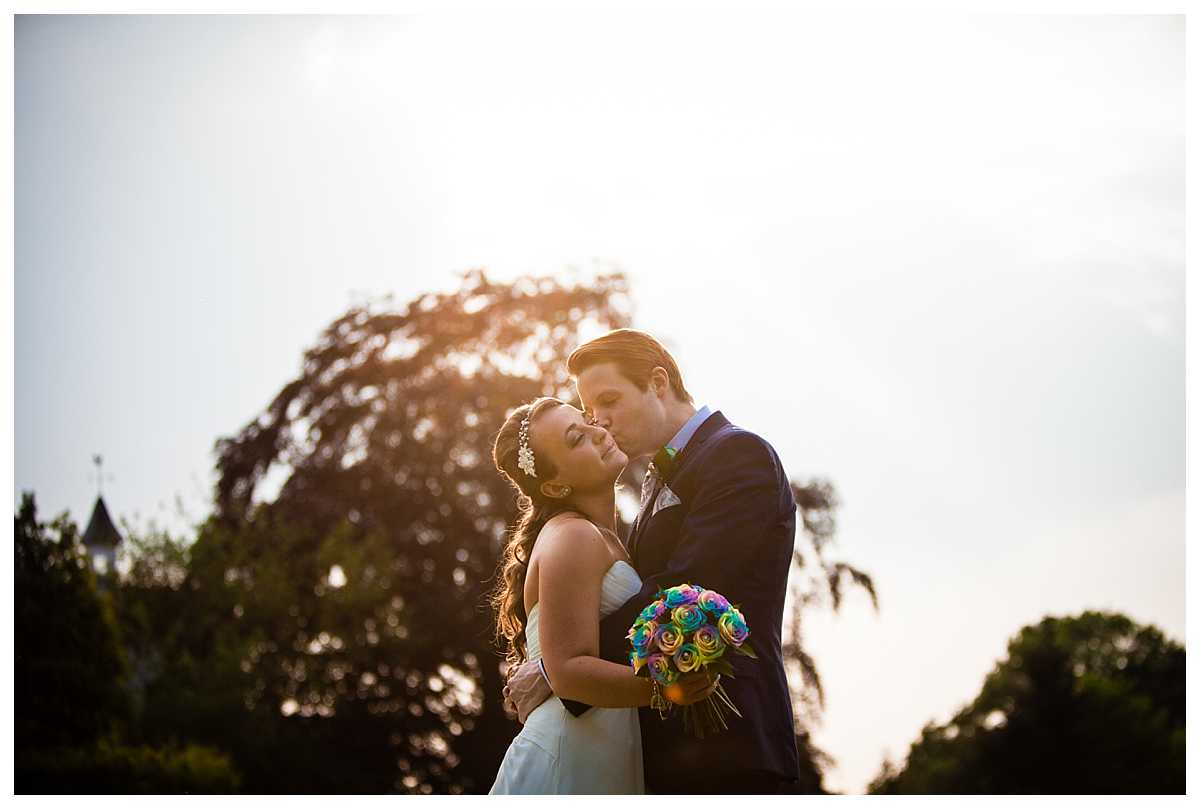 bride and groom having a moment with one another in golden hour at northop hall wedding venue