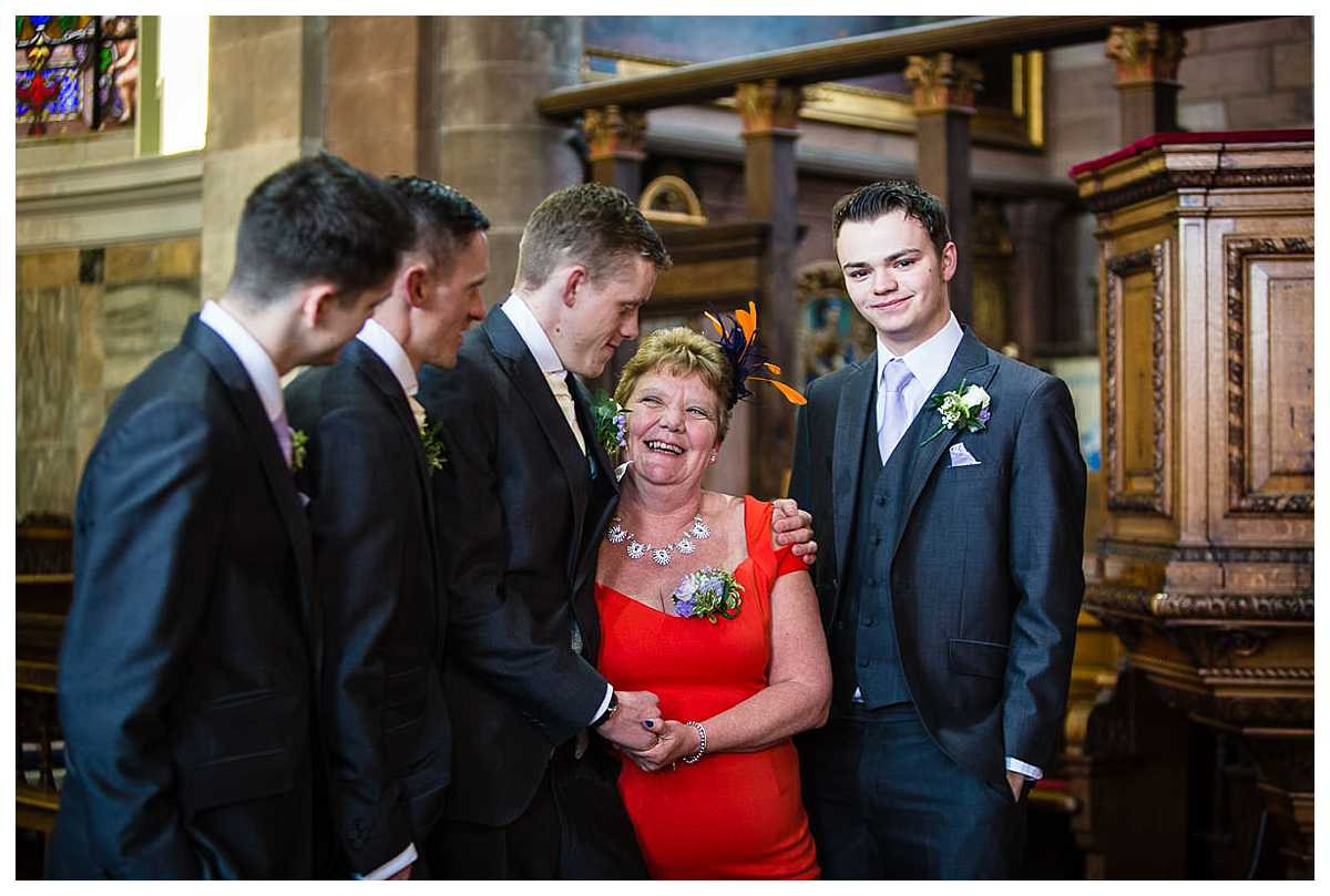 mother having photo with her 4 sons as it is raining outside so went back in st alkmunds church whitchurch
