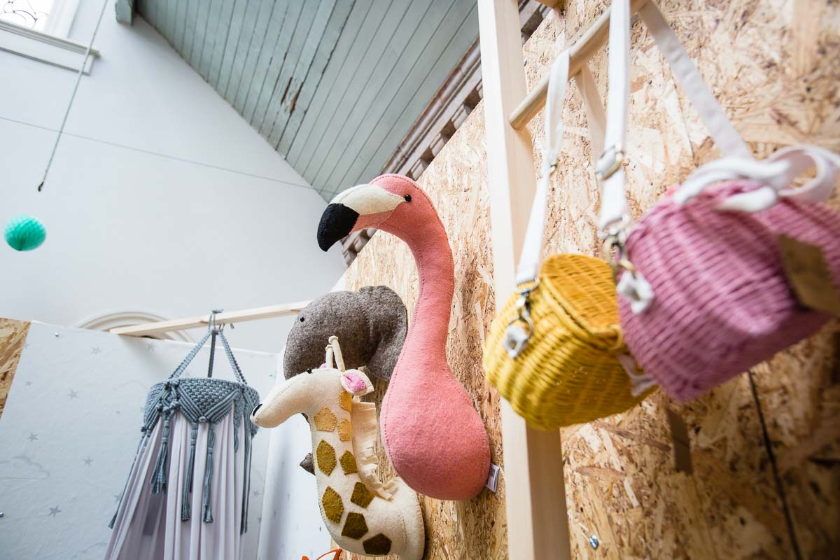 flamingo wall hanging and colourful woven bags by modern little people