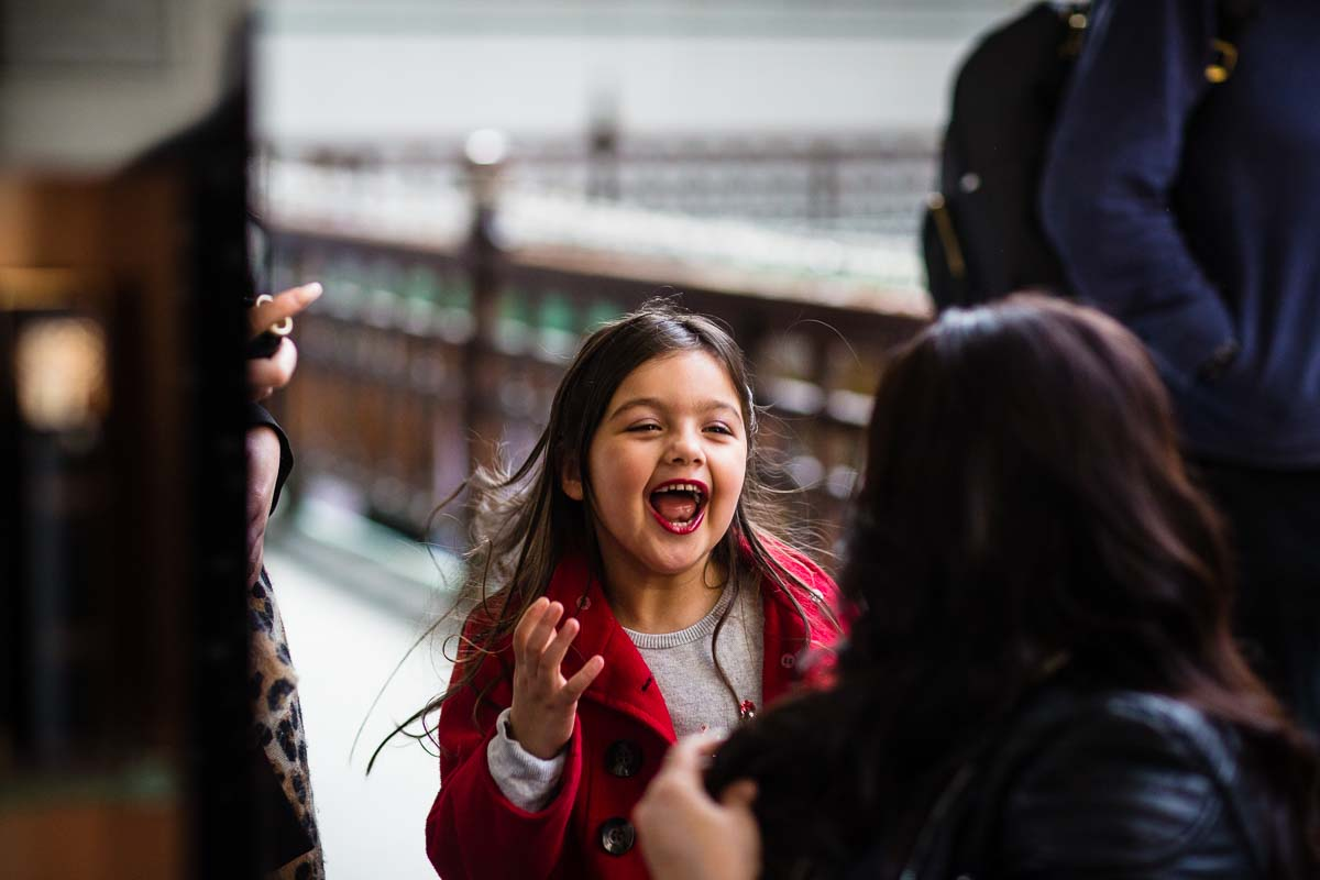 little girl looking very excited after just having her hair and makeup being done with harvey nichols at parentfolk event