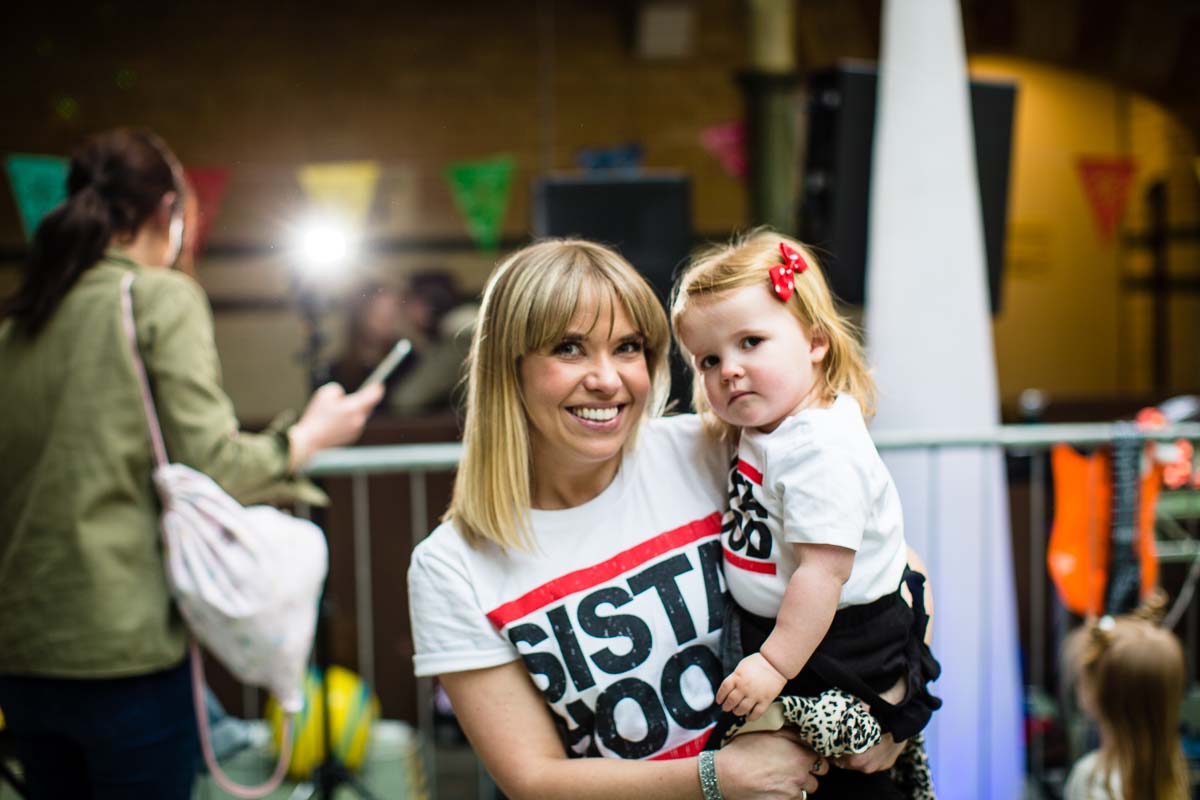 mother and daughter portrait as they dance at victoria baths event in manchester