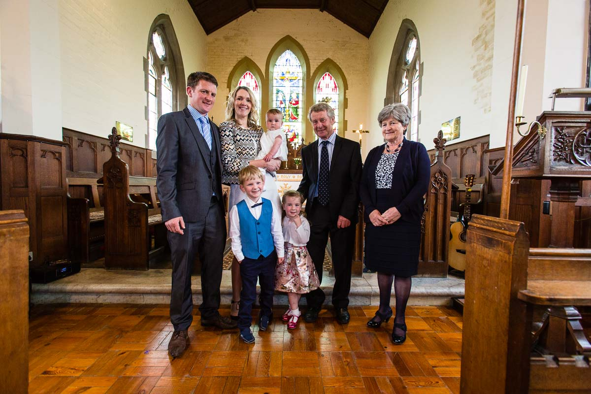 family photo at the front of the church in Ash Christ Church