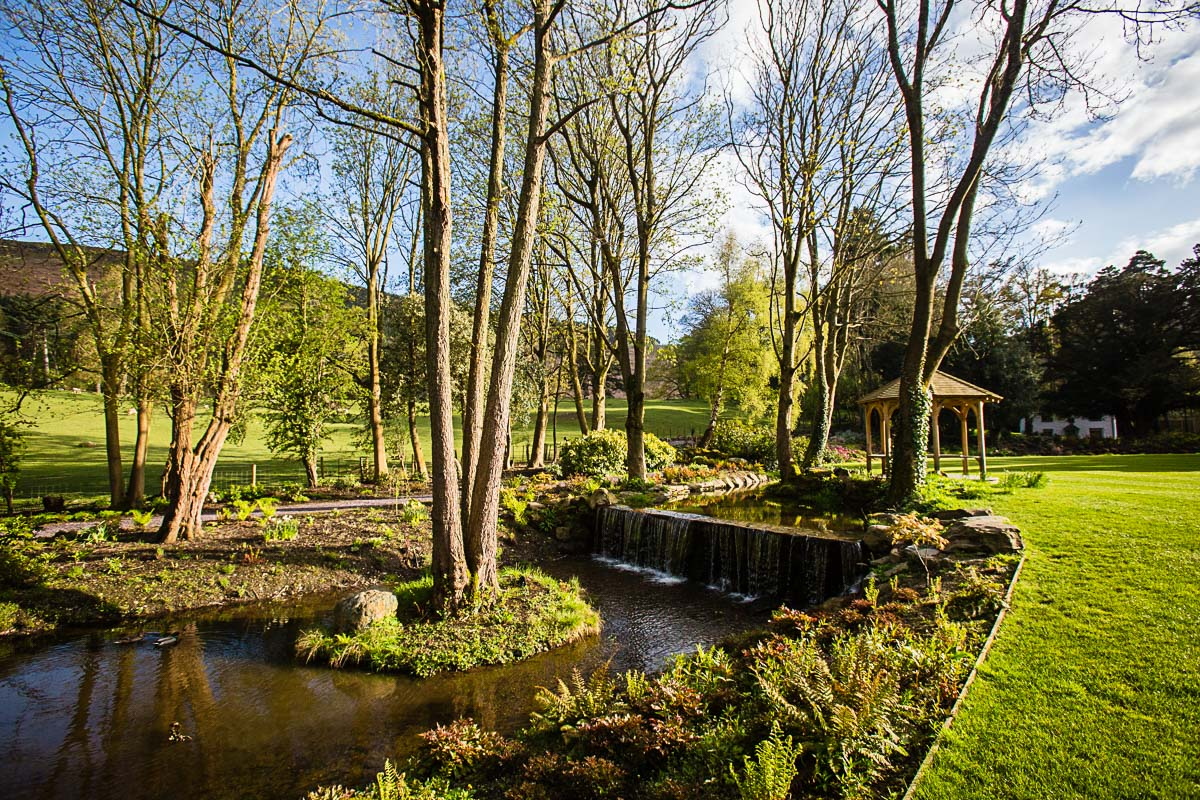 beautiful stream and well looked after lawns at welsh wedding venue Tyn Dwr Llangollen