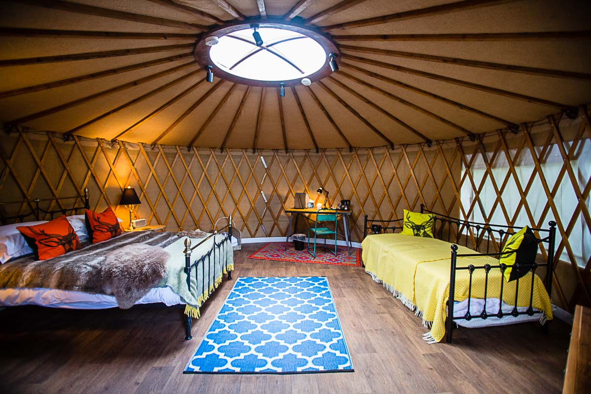 colourful decor in yurts at Tyn Dwr with rustic look with wooden flooring