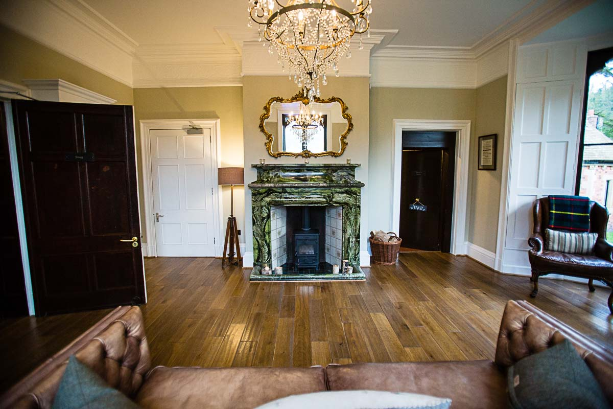one of the living rooms at tyn dwr wedding venue with spectacular marble fireplace