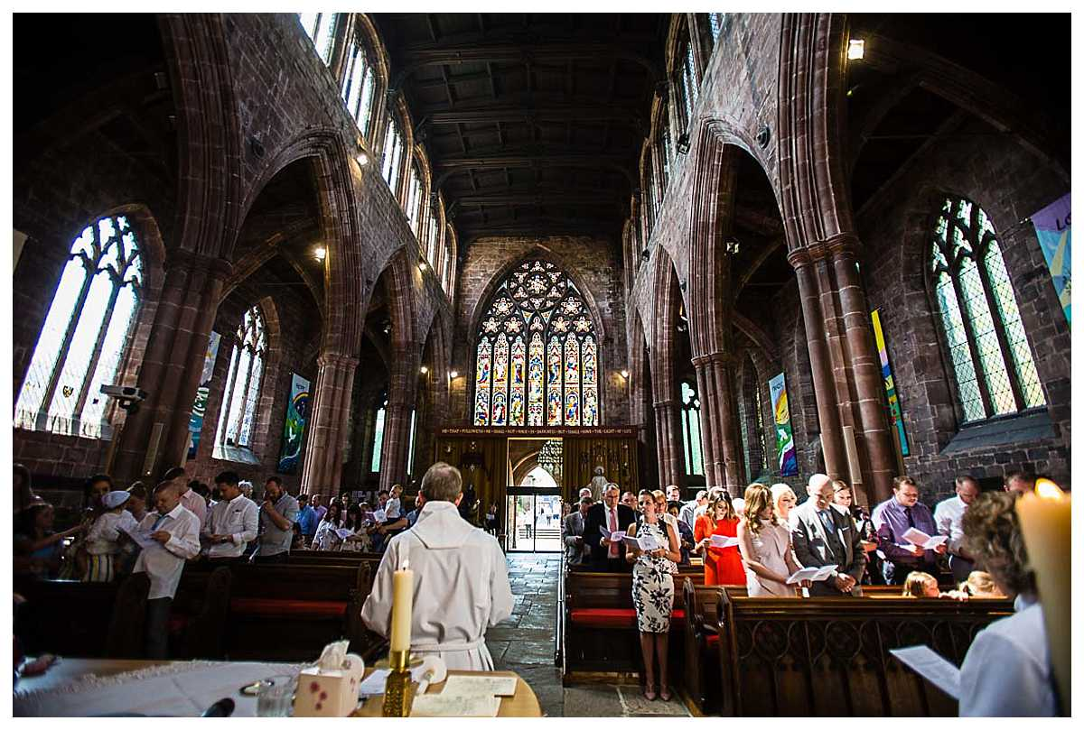 St. Mary's Church, Nantwich conducting a christening service