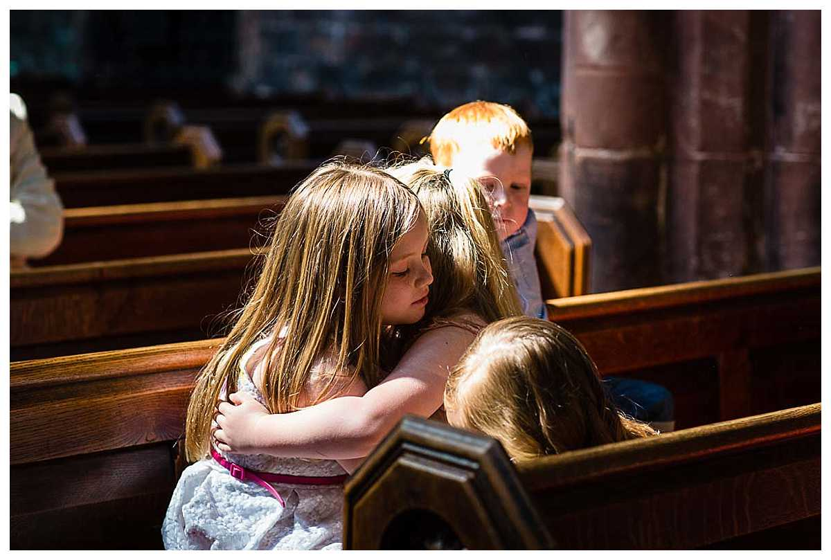 kids at the christening cuddling in church and looking very cute