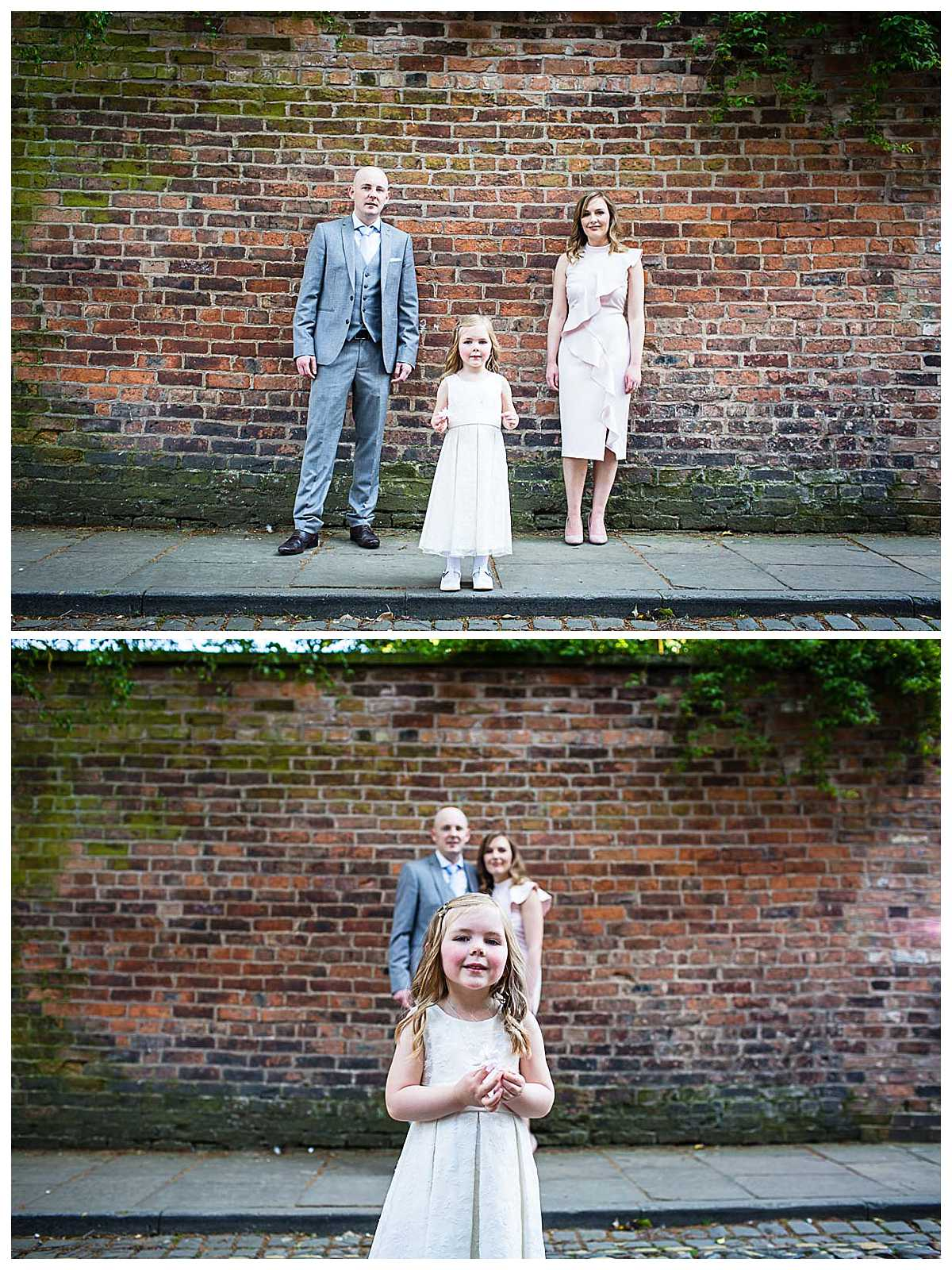 little girl with her mum and dad cool portrait against red brick wall in nantwich