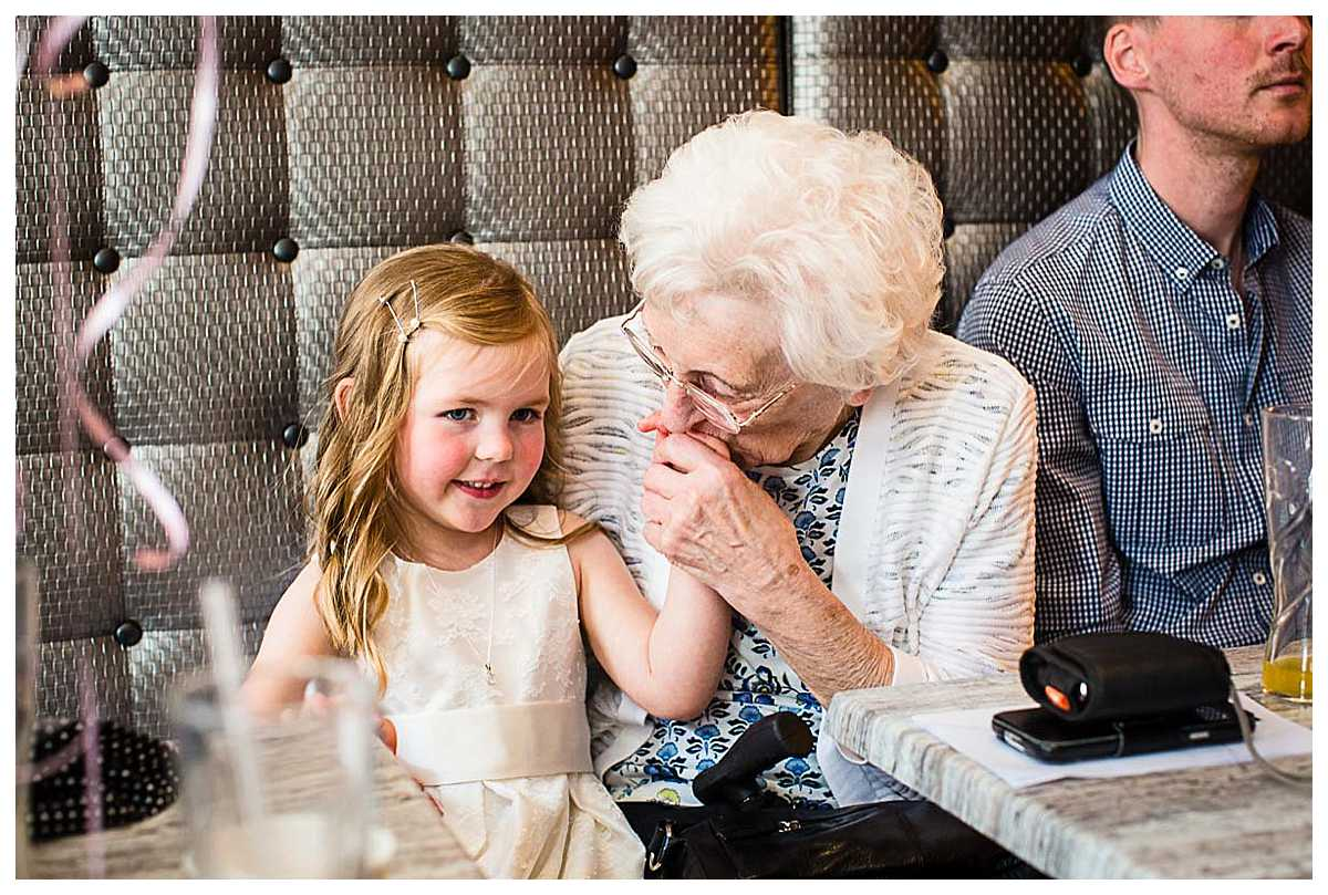 nanna absolutely besotted with little granddaughter and kissing her hand
