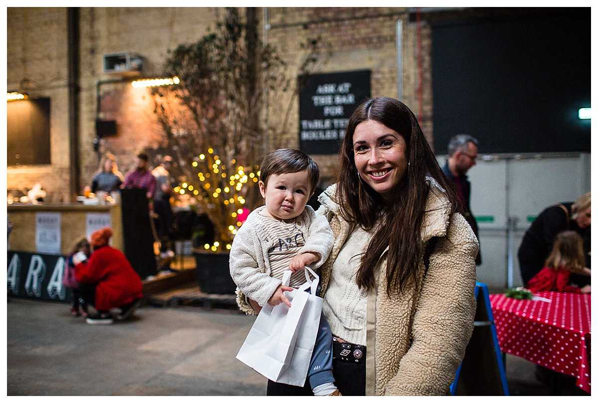 stylish brunette mum with her little boy after being shopping with the boutique sellers at camp and furnace event liverpool