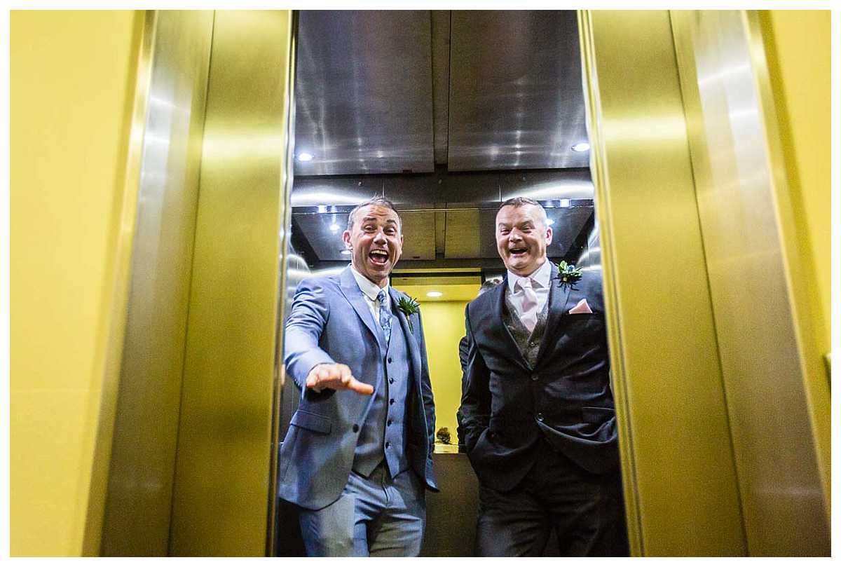 groom reacting to the lift door closing he ad best man are in hysterics