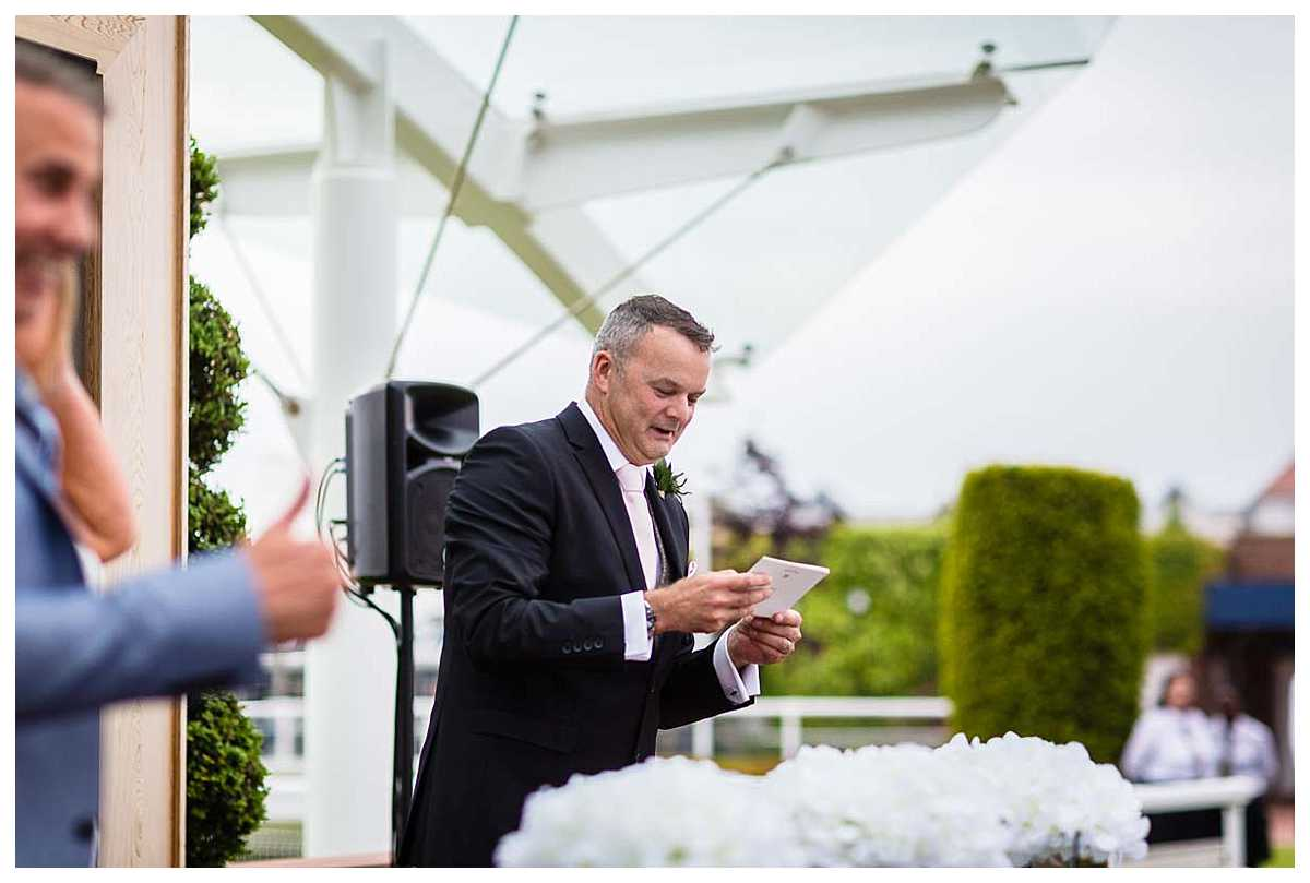 best man running the service at outdoor ceremony at chester racecourse