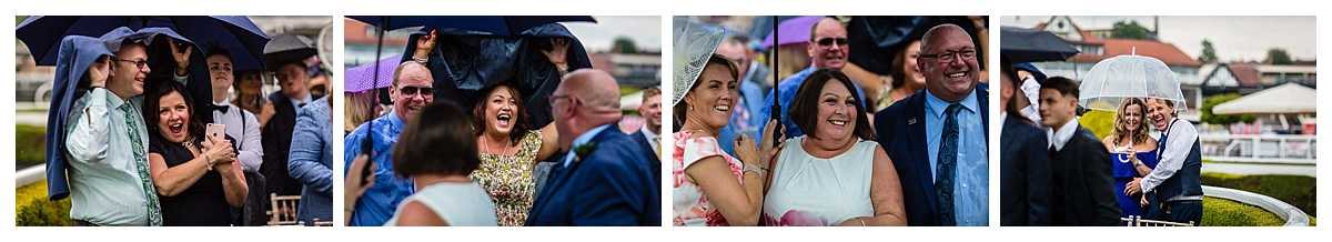 guests covering themselves with jackets and umbrellas as it rains during at chester racecourse