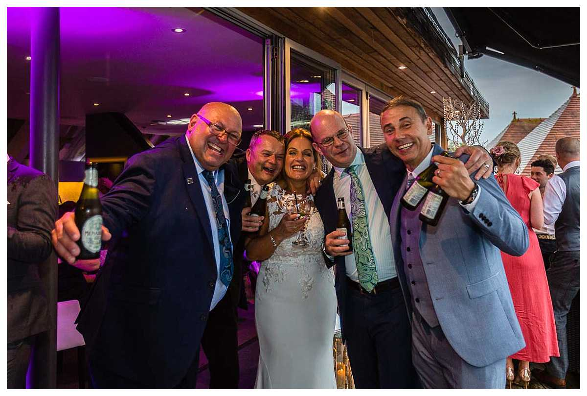 guests at 1539 raising a glass - chester racecourse wedding photographer