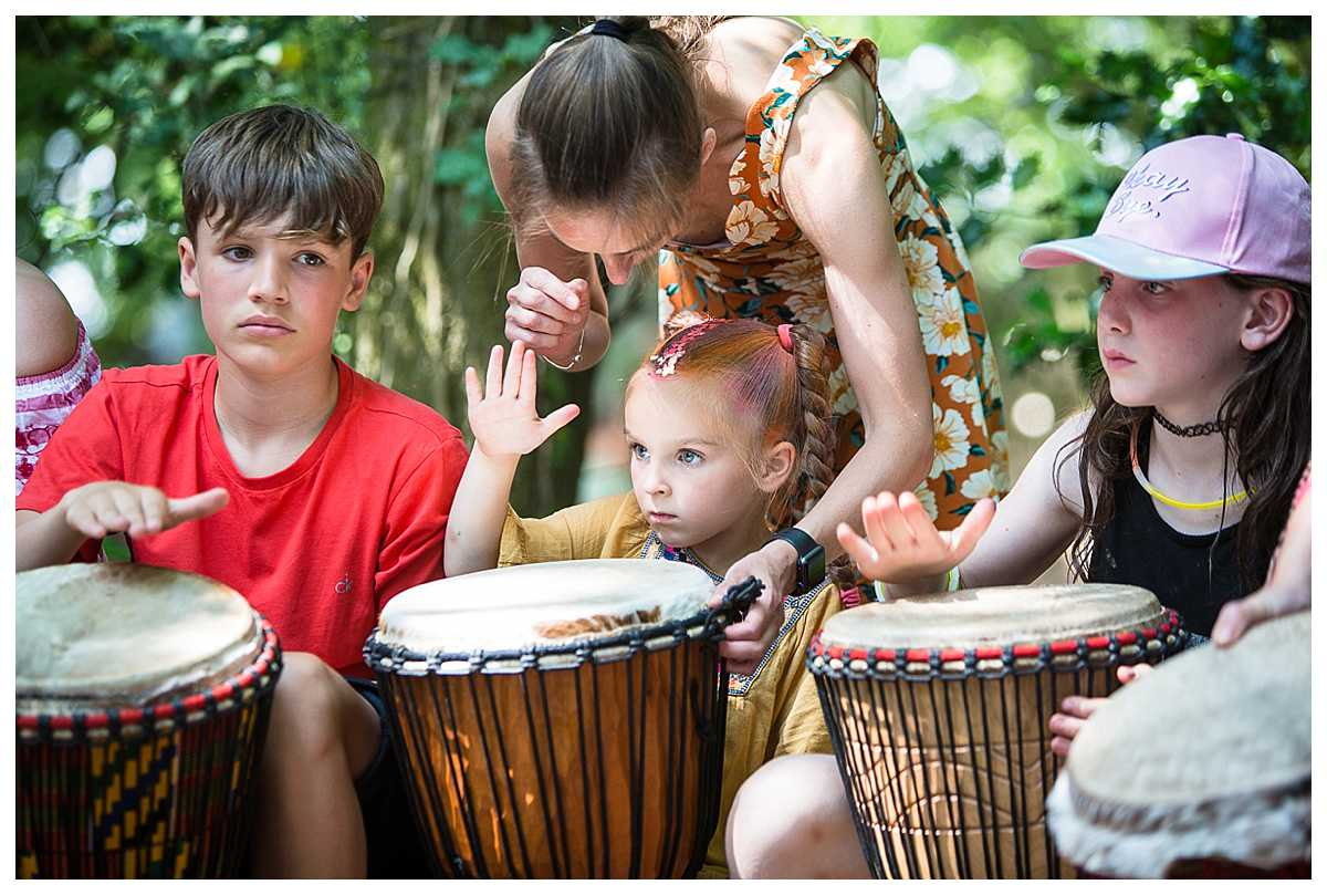 mum helping child learn how to play the drum - wirral event photographer