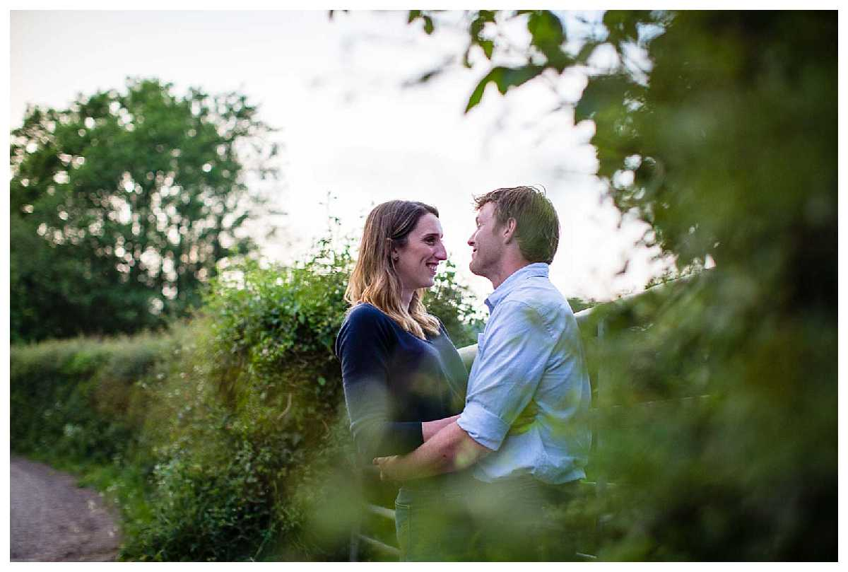 happy couple giggling and exchanging glances during shropshire pre-wedding shoot