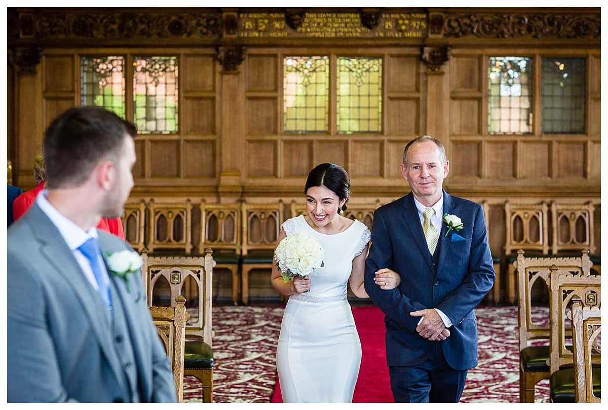 bride looking incredibly excited when she catches first glance of her groom