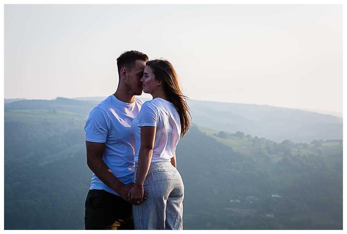 bride and groom in the evening breeze up castell dinas bran enjoying each others company
