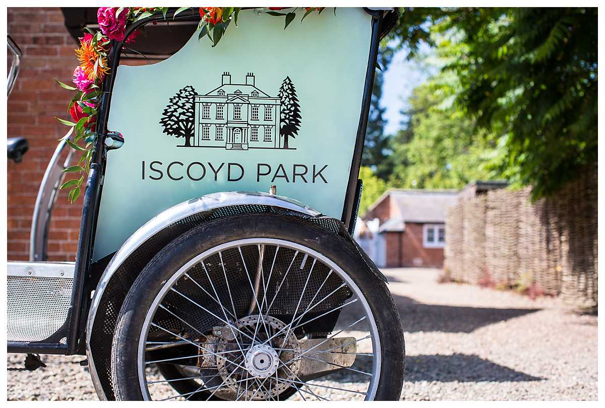 personlised iscoyd park tricycle parked up at shropshire wedding venue
